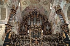Overwhelming.  Organ and painted sanctuary in the Basilica of the Holy Trinity, Lezajsk monastery, Poland.  Not a square inch appears to be unadorned.