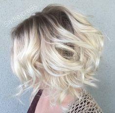 Voluminous blonde waves by Sadie Gray