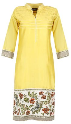 Yellow floral embroidered kurta set by EKRU. Shop this designer now at…