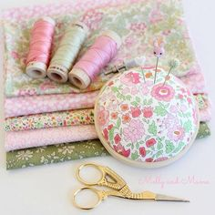 A beautiful bundle of pink and green Liberty of London fabrics, with coordinating Aurifil floss and a stunning Ava and Neve pin cushion.
