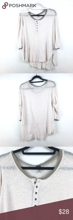 "Free People Blush Henley Tee 3/4 Sleeve M 470 Free People We The Free Blush Henley 3/4 Sleeve Tee Women's Sz Medium Top 470  Measurements: Bust:   23.5"" Flat Across Length:  24-30"" Long  In good preowned condition with no known major flaws and light overall wear. Does have a small hole near hemline on front of shirt see close up images.  The shirt already has a distressed vibe so it blends in. Free People Tops Tees - Long Sleeve"