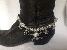 This blinged out clear crystal and silver skull and crossbones make your boots mean business! !Adjustable and works with any boots from cowboy boots