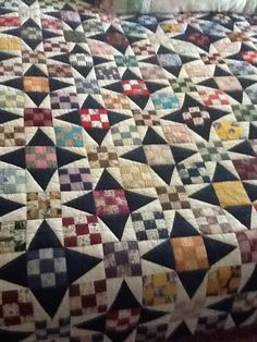 """This wonderful quilt was pieced by my Mother in Law, and quilted by her Quilting Bee in Graham, Texas.  It was an exchange block of 3"""" nine patches, and she made this great star quilt by adding a simple triangle patch.  Amazing!  What a treasure."""