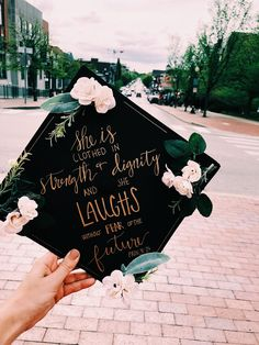 My graduation cap from 2018!! Black card stock, fake flowers from hobby lobby, and a gold paint pen. Voilà!