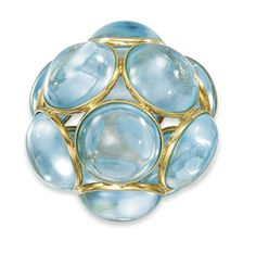 A BLUE TOPAZ PENDANT  Of spherical design, composed of circular-cut topaz cabochons in spectacle settings, 4.5 cm. diameter