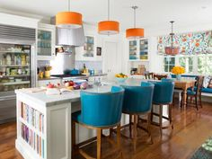 A glass-front fridge, super-big island and fun colors make this #kitchen a conversation starter. #hgtvmagazine http://www.hgtv.com/design/rooms/kitchens/a-professional-kitchen-right-at-home?soc=pinterest