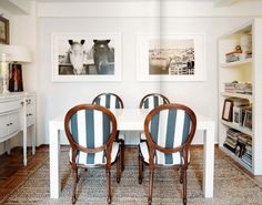 Love the fibrous woven rug with the wooden chairs; white-matted photos; stormy sea fabric for Lonny Magazine via Cup of Jo