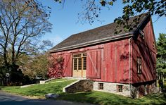 Penny Drue Baird teamed with Irwin Weiner, who handled the architectural design, to transform a 19th-century barn (above) on her clients' Bucks County, Pennsylvania, property into a 4,000-square-foot space for entertaining and housing guests