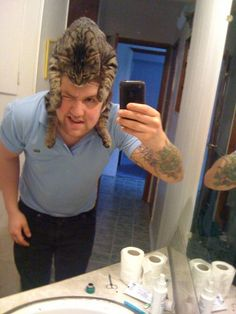 Who can resist a man with a cat on his head?!
