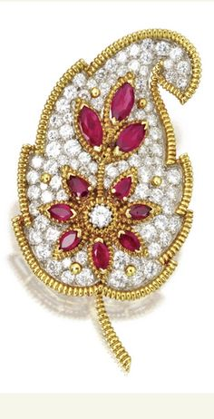18 KARAT GOLD, PLATINUM, DIAMOND AND RUBY LEAF BROOCH, VAN CLEEF & ARPELS, NEW YORK Set with round diamonds weighing approximately 6.00 carats, and marquise-shaped rubies, signed Van Cleef & Arpels, New York, numbered 34294, maker's mark.