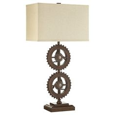 Bring industrial style to any room with the Verona Home Orden Industrial Gear Table Lamp. The rust colored table lamp features an industrial gear design, adding chic style to your home. A tan, rectangular shade completes the look. Rustic Table Lamps, Metal Table Lamps, Fabric Lampshade, Steampunk Design, Bronze, Industrial Style, Industrial Lighting, Lamp Light, Gears