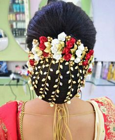 What a beautiful large low bun with real flower gajra & golden net! Care however should be taken before adopting such hairstyles, as due to it's high static charge, it will cause phlegm to move up in the throat, causing the voice to quaver & a frequent urge to clear the throat. A heavy chabi chhalla with a long & wide hook if inserted at the edge of the pleats of the saree, will reduce this problem as it's hook will activate the acupressure points that act to keep the throat clear.