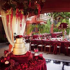 Gold sheen on cake, garnet wrapped cake table.