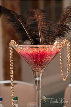 Using tall martini glasses as table centre pieces adds that elegant and glamorous feel of the 1920's.
