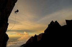 Mark Synnott rapping back to the wall camp. Low's gully. Mt Kinabalu Park - Jimmy Chin