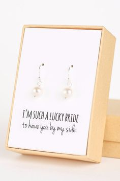 "Show your besties what a LUCKY BRIDE you are with those sweet freshwater pearl dangle earrings. Plus, use ""WEDCHICKS"" in the note for free shipping!  See more here: https://www.etsy.com/listing/238001693/pearl-silver-drop-earrings-freshwater?ref=shop_home_active_15"
