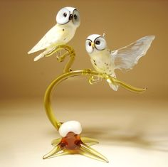 Glass Polar Owls on a Branch