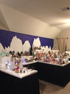 2014 Department 56 North Pole - collection of 80 buildings. I carve the styrofoam and make the landscape using Hotwire Foam factory tools.