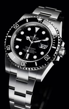 The 'Sub C' - Rolex Submariner Date. Steel. Ref. 116610LN. 40 MM. (Note, LN is short for Lunette Noir, french for black bezel.) The LN finally gets the maxi-dial, maxi-case, ceramic bezel and Glidelock bracelet.