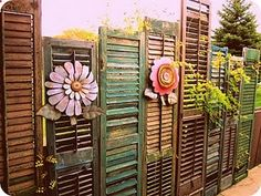 Privacy fence made of assortd old shutters. #privacyfenceidea #repurposed #diy - Rugged Thug