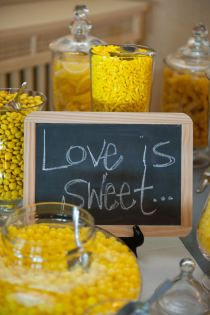 """little candy bar with chalkboard """"Love is Sweet""""-- cute idea for a wedding shower or something along those lines."""