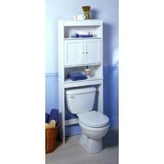 Don't lose space over the #toilet in your #bathroom!  You can purchase pieces like this removable cabinet-shelf to help maximize that space.