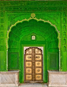 Door of Ganesh - Peacock Courtyard in the City Palace of Jaipur, adorned with four exquisitely painted doorways representing the four seasons.