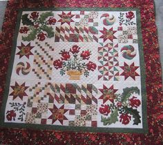 I love this combination of pieced and appliquéd blocks