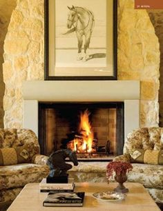 Stone fireplace with large horse print in warm rustic living room
