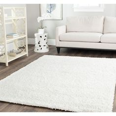 I'm afraid of white, but this falls RIGHT into my design... to buy or not to buy... Safavieh Cozy Solid White Shag Rug