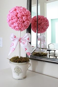 "Valentine's Crepe Paper Roses Topiary 5"" foam ball, 1 roll of crepe paper, vase, foam square, 12"" dowel, Moss to top the base, Ribbon, Glue gun. Would also be cute with flowers on part of the ball, just sitting in a (painted) flower pot."