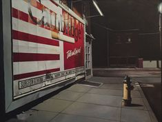 """Fifth Street, 1993, Tobin Sprout, American b. 1955, 42 x 32 inches, oil on canvas, $29,400 – 2018 listed large photorealism from Tobin Sprout shows a deserted street corner surrounded by downtown buildings in Dayton, Ohio. A large cigarette billboard is over exposed in light with a prominent flag theme and giant, legible warning. Reflected light baths corner in fluorescence, evocative of Edward Hopper urban night scenes of the mid-century. Featured in Flood's three-part essay, """"Carefully… Edward Hopper, Photorealism, Oil On Canvas, Mid Century, Urban, Night Scenes, Street, Dayton Ohio, Billboard"""
