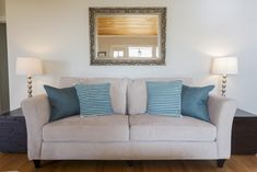 Lawson-style sofa. Designed for comfort. Its signature design element is a back comprised of pillows separate from the frame.