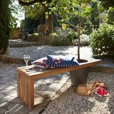 Bench with a Flower Pot as one of the legs.  Seems simple enough to DIY!