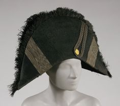 Bicorne Hat: This hat was popularized by Napolean Bonoparte. This hat could be flattened to be worn under the arm rather than being worn. Also called Chapeau Bras. 1800s Fashion, Vintage Fashion, Mens Fashion, Napoleon Costume, Pirate Hats, Philadelphia Museum Of Art, Metal Buttons, Historical Clothing, Headgear