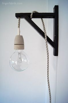 Materials: Valter Shelf Holder, Textile Cable, Porcelain Bulb Holder, Large Bulb, Spray Paint  Description: Cable Lamp from a Valter shelf holder.  I want