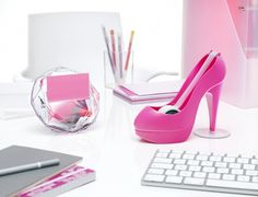 Girly office. Perfect pink office decor for the fashionista. Love the hot pink high heeled shoe tape dispenser!
