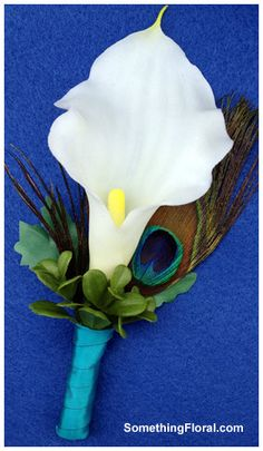 Calla Lily and Peacock Feather Boutonniere  by SomethingFloral, $13.50.  https://www.etsy.com/listing/123127169/calla-lily-and-peacock-feather#