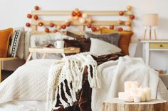 Fall is in the air and that means its time to pull out the cozy sweaters and get your mugs ready for your favorite hot drinks. But don't stop there! Here are a few ways to bring the Harvest colours and bounty into your home! #fallhomedecorating #elegantlivingstaging #fallstaging #homedecor