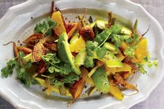 A Girl and Her Pig's Carrot, Avocado and Orange Salad Recipe on Food52: http://food52.com/blog/9632-a-girl-and-her-pig-s-carrot-avocado-and-orange-salad #Food52