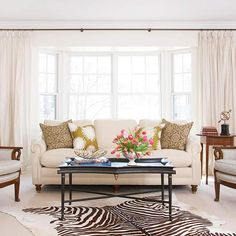 Upbeat patterns -- on the pillows, chairs, and even the floor -- add a contemporary twist to traditional furnishings, giving this formal living room everyday appeal.