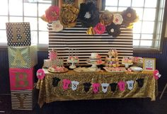 Seruhrosedesigns Kate spade inspired baby shower backdrop diy party planner event setup paper flowers pink black gold stripe designer baby blocks