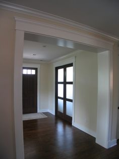 for upstairs - ties in basement and crown moldings already here.molding for upstairs - ties in basement and crown moldings already here. Moldings And Trim, Crown Moldings, Window Moldings, Black Entry Doors, Black Door, Dark Doors, Front Doors, Door Frame Molding, Wall Molding