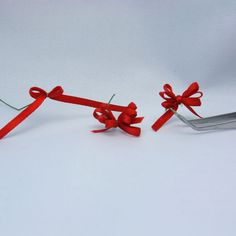 How to tie varying styles of miniature ribbon bows by changing the number of loops or the style of the center.