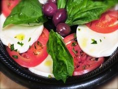 Stacks of sliced Buffalo Mozzarella cheese, fresh sliced tomatoes, Kalamata olives and basil. Toss with extra virgin olive oil & balsamic vinegar. Ta Da! Your done!