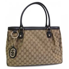 This authentic GUCCI Sukey Original Tote Bag is finely crafted from beigebrown GG canvas. The interior opens to a white textile. This classic design by GUCCI features light gold-tone hardware a natural cotton lining double handles with a 16.5cm drop and generous interior with multiple compartments. This tote is an ideal everyday bag Find more at http://www.swayy.com.au
