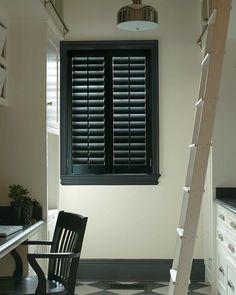 black louvered window shutters set in a dark gray painted window frame. White Shutters, Interior Window Shutters, Wood Shutters, Indoor Shutters For Windows, Bermuda Shutters, Custom Shutters, Front Windows, Window Blinds, Interior Doors