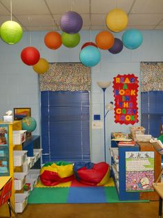 Toddler classroom decorations · preschool reading corner · the paper lanterns are so fun and i love how they help to define the space Sunday School Rooms, Sunday School Classroom, Toddler Classroom, Preschool Rooms, Daycare Rooms, Kindergarten Classroom, Classroom Decor Themes, School Decorations, Classroom Design