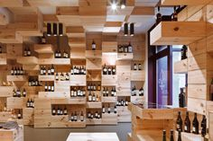 The intent of the interior design is to present an image of a landscape consisting of wine cases in which the high-quality wines are presented together with their cases as in a museum gallery.  Wine store in Zurich.