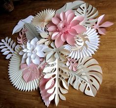 If you are looking for a background for your special day and are tired of the excess of paper flowers, pay attention to the leaves. They look more intricate and sophisticated. On your wall they will create an ineffable lacy pattern and will be a decent backdrop for your wedding photos. Just imagine yourself in your fabulous wedding dress on the background of an exquisite pattern of large paper leaves and flowers! I would loved to have one on my own reception:) You can play with colors…